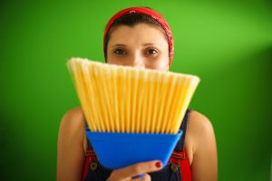 Image of woman with broom for Home Cleaning page